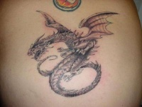 Black ink dragon tattoo