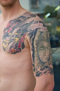 Dragon and buddha tattoo on arm by graynd