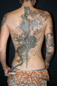 Great dragon and sword tattoo on back
