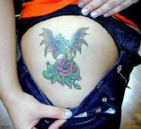 Blue dragon and rose tattoo